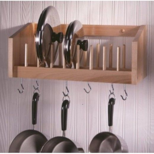 Made by Woodform out of handcrafted select northern hardwoods, this pot and pan rack not only has six hooks to hang your favorite pots and pans,  it conveniently stores the lids on the shelf above.