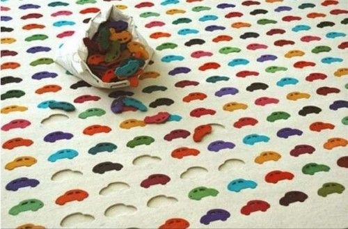 Children's Play Rug by Youlka Design - very cool but I can imagine a lot of lost pieces in this house lol.