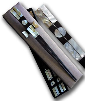 MOON GATE TWO CHOPSTICK SET 2: Two-pair gift set of rosewood chopsticks with classic Chinese Moon Gate design in mother of pearl shell comes with matching rests in custom- made fabric presentation box.