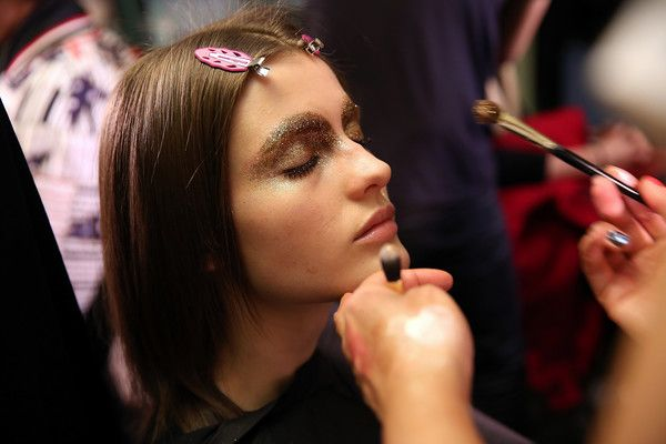 A model prepares backstage at the AREA fashion show during New York Fashion Week at Hotel Wolcott Ballroom on February 11, 2017 in New York City.