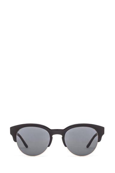 Stella McCartney Sunglasses in Black   FWRD