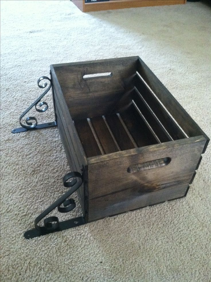 wooden crate from walmart. Stain it. Add brackets from lowes. Hang it in my bathroom for extra storage. Add apothicary jars and fill with qtips and cotton balls.