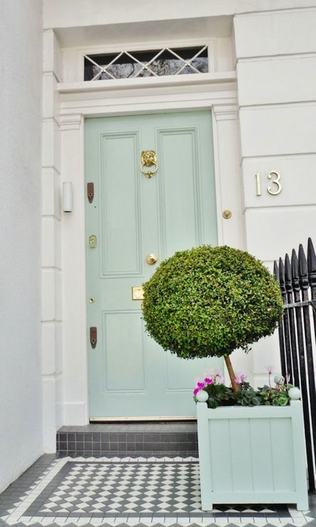 Seafoam green door with lion head knocker