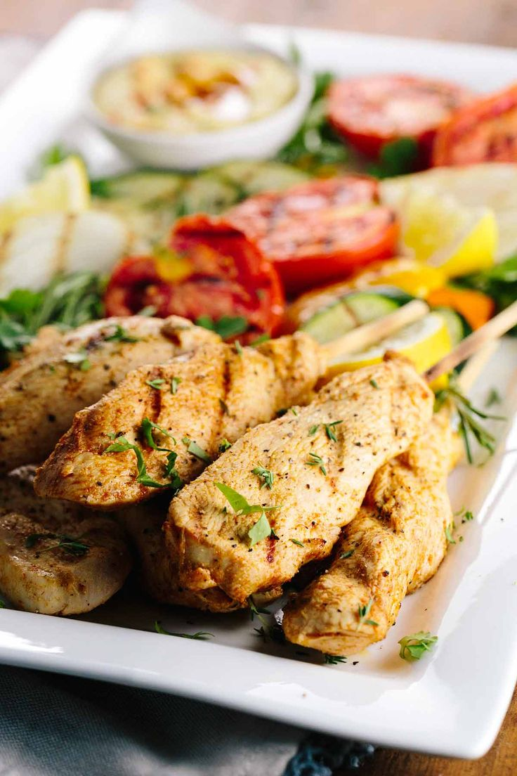 Greek Style Chicken Skewers and Hummus - Marinate the chicken for a few days to infuse the lemon, herb, and garlic flavors for a delicious and healthy dish. | jessicagavin.com