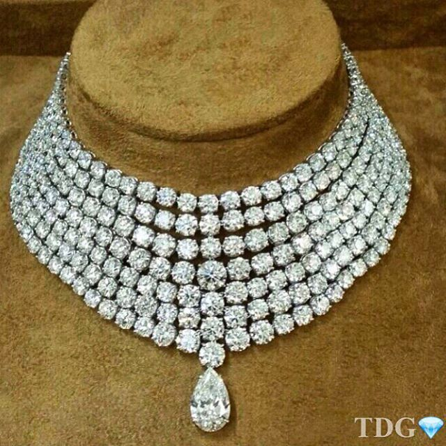SEVEN STRAND DIAMOND NECKLACE WITH A PEAR DROP~ 222 carats of round diamonds, and a 9 carat pear shaped diamond.
