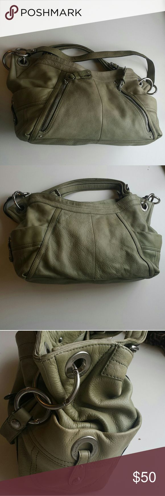 "B. Makowsky purse Olive green large shoulder bag. 100% leather with heavy silver tone hardware and has magnet closures to main compartment and both side pouches. A little discoloration to the leather due to normal wear (it would look great after a good cleaning).  Small pen marks (3-4) on the inside flap shown in last picture.  10"" Tall 20""  At its widest which is the top 4""  Space width b. makowsky Bags Shoulder Bags"