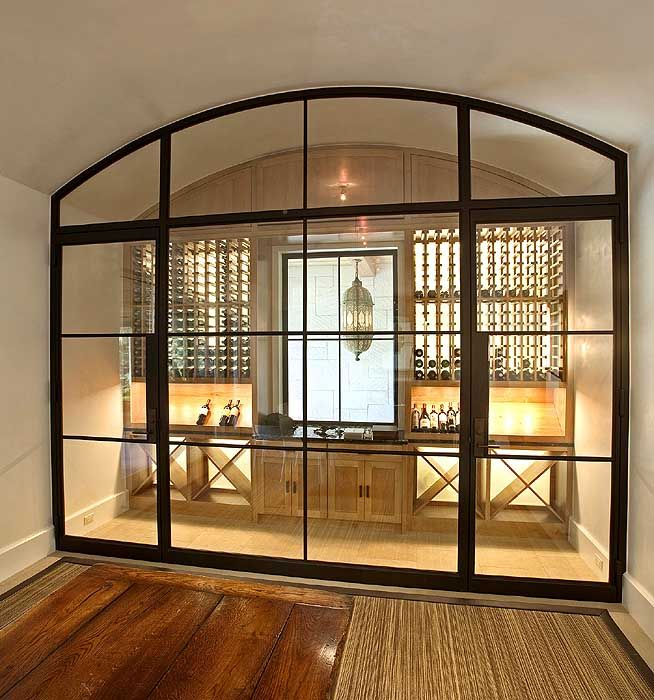 wine storage.  love the doors as dividers.  would be great in basement too for a home gym or music studio.  home decor and interior decorating ideas.