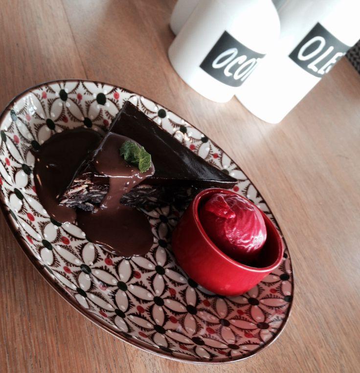 Chocolate and nut cake with warm dark chocolate sauce and home-made ice-cream