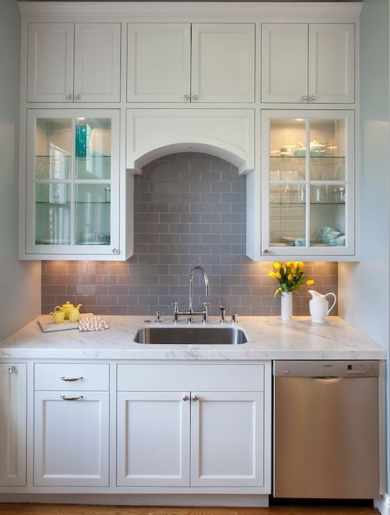 grey glass subway tile backsplash in classic white kitchen found at https