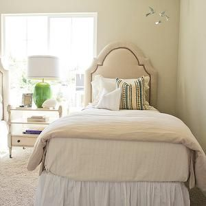 Sherwin Williams - Naturel - beige wall to wall carpet, arched headboard beige bedding, beige bed linens, white bed skirt, nightstand in front of window,