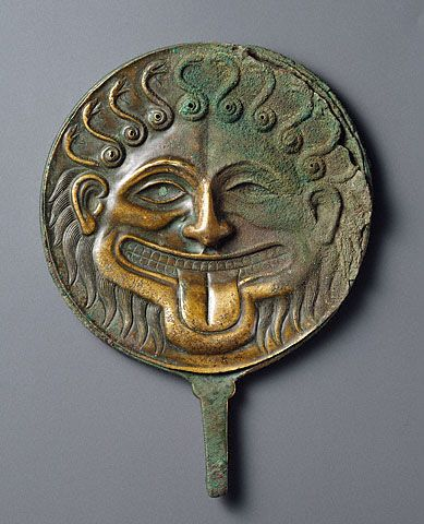 Hand mirror with the head of Medusa  Greek, South Italy, 500 - 480 B.C.  Bronze  The J. Paul Getty Museum