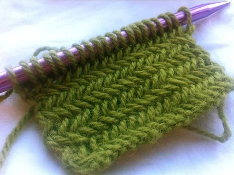Herringbone stitch tutorial. This is one of the *best* knitting tutorials I've ever seen; notable mainly b/c it's presented by a man. It was weird at first to see a man's stubby fingers knitting this pattern, but his explanation was great. :-)