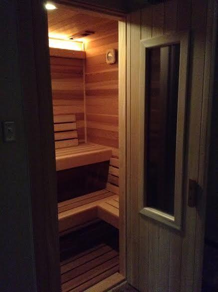 Small But Elegant Sauna Built Into A Basement Storage Closet.