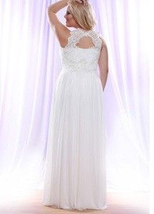 Plus size wedding dresses with an open keyhole back are available. This sleeveless bridal gown is fitted under the bust line.  The bodice cut of this plus size wedding gown is in a halter style. See other plus size #weddingdresses by visiting our website at www.dariuscordell.com