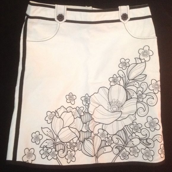 """Nanette Lepore Black & White Cotton & Lycra Skirt Nanette Lepore Fun & Flirt Bone& Black Floral Cutout Skirt!  Gorgeous detail with cut out floral pattern and enameled button. Trimmed in black detailing and fun front pockets Measures  Waist 17"""" Flat/ hips 19.5 Length 22 inches of Pure Fun! Nanette Lepore Skirts"""