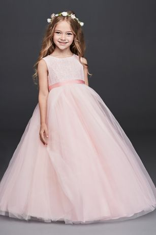 Flower girls will feel like they're living in a real-life fairy tale in this ball gown with a full tulle skirt and lovely lace bodice. The sweetest part: a heart cutout and bow in the back.  Polyester  Button closure; fully lined  Dry clean  Imported  Includes sash in same color as dress  White and soft white dresses shown with STNRN sash inquartz ; whisper pink dress shown with STNRN sash inBallet, sold separately