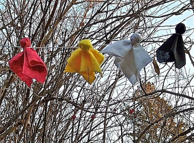 Prayer ties, sometimes called prayer flags, representing the four directions are offered to The Great Spirit in exchange for blessings.