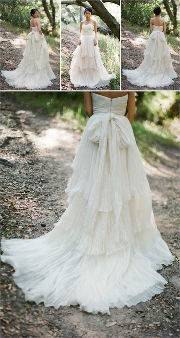 Lace wedding dress with ruffled tiered train