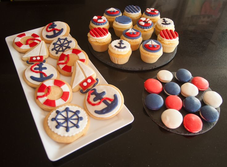 Our custom made cookies and cupcakes in a nautical theme.