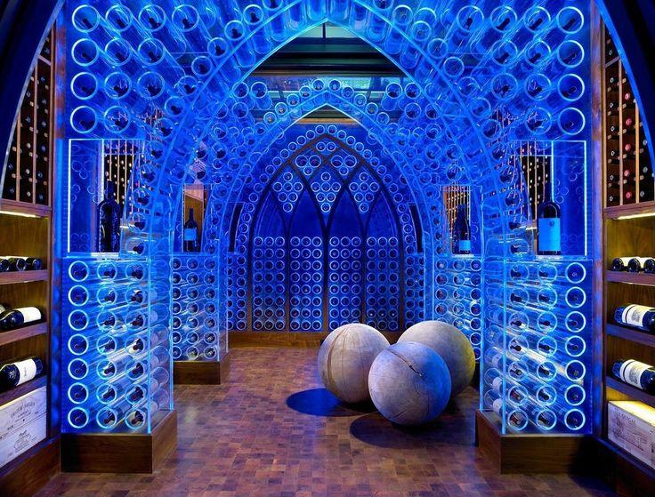 Eclectic Wine Cellar with Columns, Built-in bookshelf, herringbone tile floors