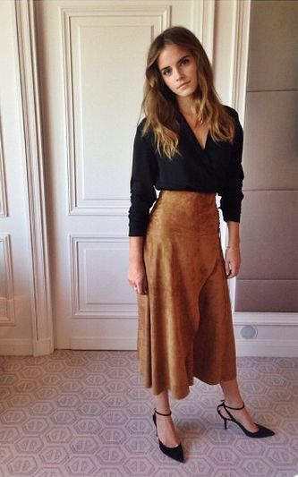 Emma Watson...love her skirt and top here...definitely not the same shape as her but could be a nice work look