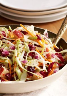 Easy Apple-Cranberry Slaw -- Cranberries, apples and cabbage bring the colors and flavors of fall to your dinner table in this crunchy coleslaw.