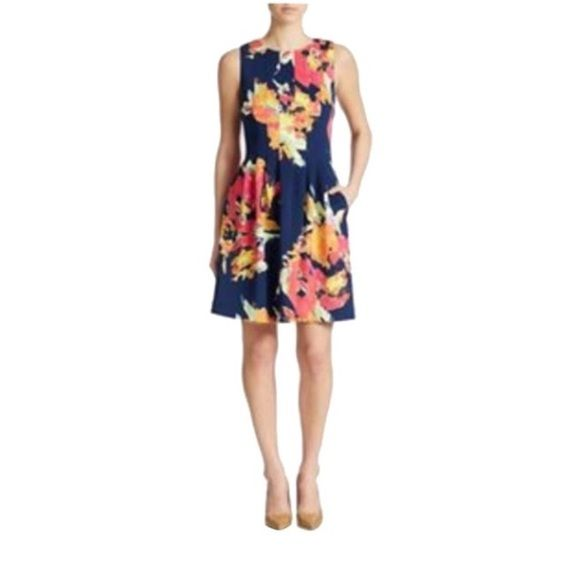 "NWOT Vince Camuto scuba dress size 6 NEW WITHOUT TAGS!! Vince Camuto new without tags navy floral scuba dress. Fabric has some stretch to it. Bust:16"" Waist:14"". ALL PRICES ARE FIRM. SORRY BUT ALL OFFERS WILL BE DECLINED. THANK YOU. Vince Camuto Dresses Midi"