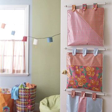 DIY Hanging Storage Bags~ great for hanging on the back of the door for organizing, Barbies, cars and other small toys. Zippers on the sides of each bag let a child open it for use as a play surface too.