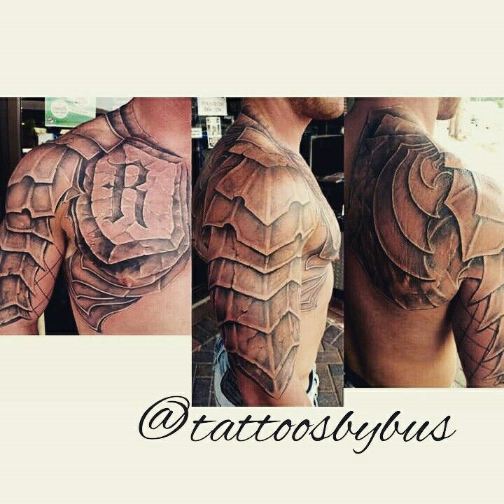 Black and grey armor tattoo by Bus at Tattoos Forever in Fort Walton Beach, Florida.  www.tattoosforever.com