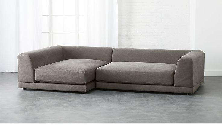 Shop uno 2-piece sectional sofa.   Two super-easy, super-scaled pieces make one roomy hangout.  Super-deep with low angled back for lazy lounging and piles of pillows.  Clean modern texture in tight poly-cotton weave.