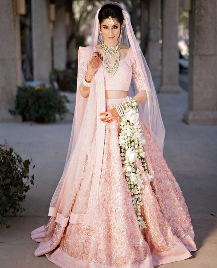 Beautiful Indian Bride in baby Pink Bridal Lehenga and #Gajra flowers