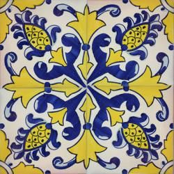 Use a few blue and white Portuguese or Spanish tiles like this on the splashpanel over the kitchen sink, surrounded by white tiles.