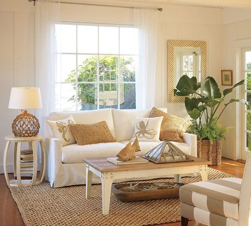 tasteful beach white living room styles for design ideas with simple white fabric sofa that have brown pillows and classic white wood rectangle shaped table - Coastal Interior Design Ideas