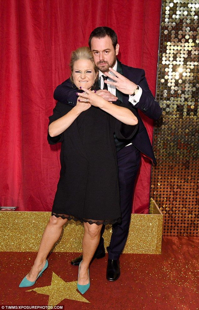 Playful: Danny hit the red carpet alongside his co-stars Kellie Bright, who plays his on-screen wife Linda on Eastenders