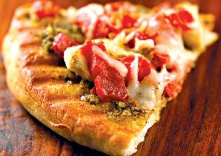 Fresh Pesto-Tomato PizzaLong after summer has turned to fall, you can savor these garden-fresh, thin-crust pizzas within minutes of taking them out of your freezer.