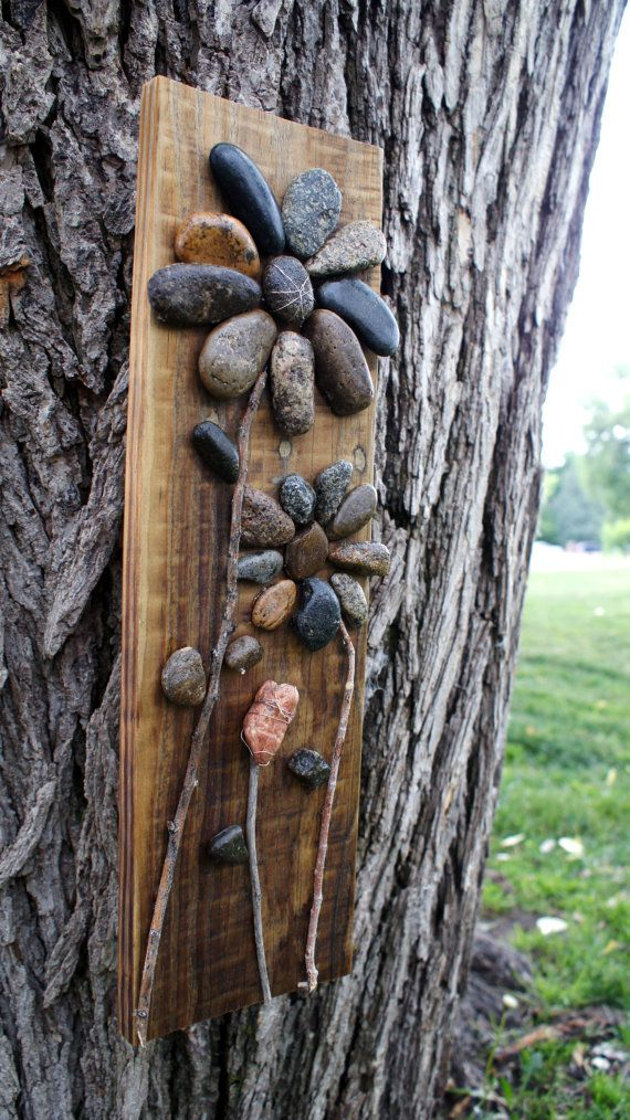 These Pebble Flowers are available as natural or sunflower. They are made from reclaimed wood and stone.  *Please note that each piece is unique, due to the nature of the wood and materials used.  A little about the Dream Catchers Studio:  Dream Catchers, located in Colorado Springs CO, provides vocational training for adults with intellectual disabilities and at risk youth.  The Dream Catchers Studio mission is to supply our artisans with the workspace, tools, recycled materials and…