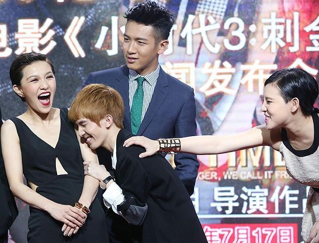 Taiwanese actress Amber Kuo, Chinese writer and director Guo Jinming, Taiwanese actor Kai Ko and actress Evonne Tse laugh at a press conference for their new movie 'Tiny Times 3.0' during the 17th Shanghai International Film Festival in Shanghai, China, June 16, 2014