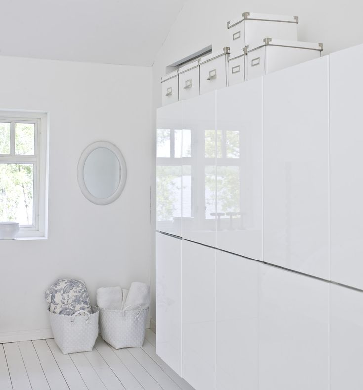Like The Old Wooden Floors Painted White. White Ikea Besta Shelf Unit  Cabinets With Doors In High Gloss White.