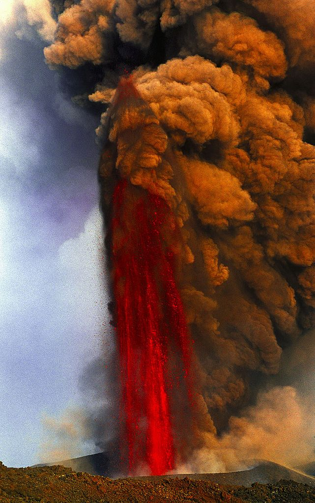 Lava Fountain of Mt Etna Volcano in Italy. Europe's most active volcano sent streams of red hot lava high into the night sky March 2013. Fountains = series of short pulses or a continuous jet of lava. The highest lava fountains ever recorded were during the 1999 eruption of this Mount Etna in Italy, which reached heights of 2,000 meters (6,562 ft). Lava fountains of Mount Vesuvius' 1779 eruption are believed to have reached at least 3,000 m (9,843 ft).  -Wikipedia Research, DdO:)