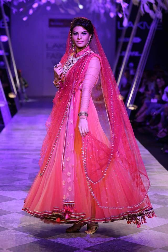 Tarun Tahiliani Lakme Fashion Week Summer Resort 2014 Jaqueline Fernandez in Indian bridal pink suit. See all Fashion Week photos here: http://www.indianweddingsite.com/indian-wedding-photo-gallery/fashion-lakme-fashion-week-summer-resort-2014/