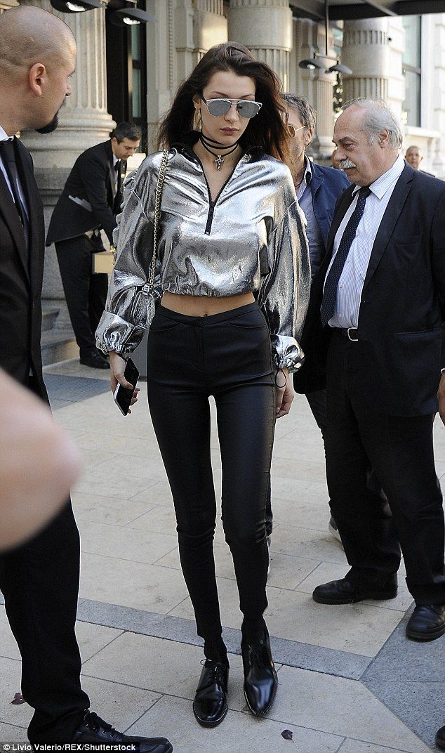 Standout: Model Bella Hadid showed off her slim waist in a shiny silver top while out in Milan on Saturday