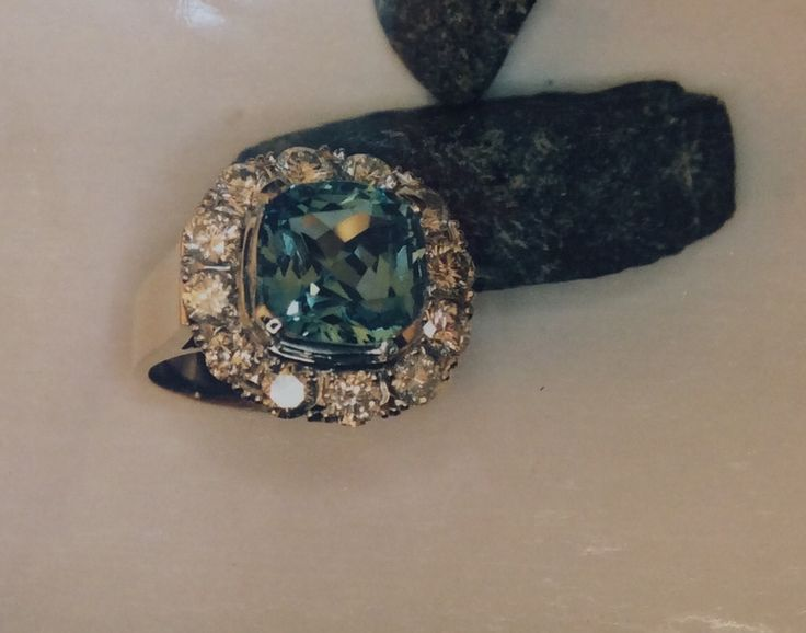 Aquamarine and diamond cluster ring on a wide flow up band