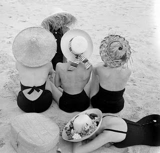 Ladies at the beach with hats