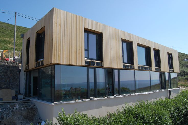 PassivHaus Project in Croyde using our HS330 Lift and Slide Doors and Glass to Glass Corners nearing completion