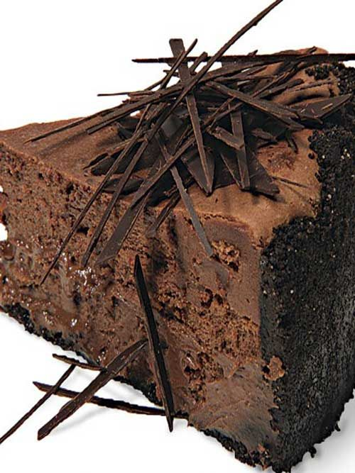 Recipe for Extreme Chocolate Cheesecake - You can't get more chocolate than this cheesecake: a chocolate-wafer crust, melted dark chocolate in the filling, and chocolate shards scattered over the top.