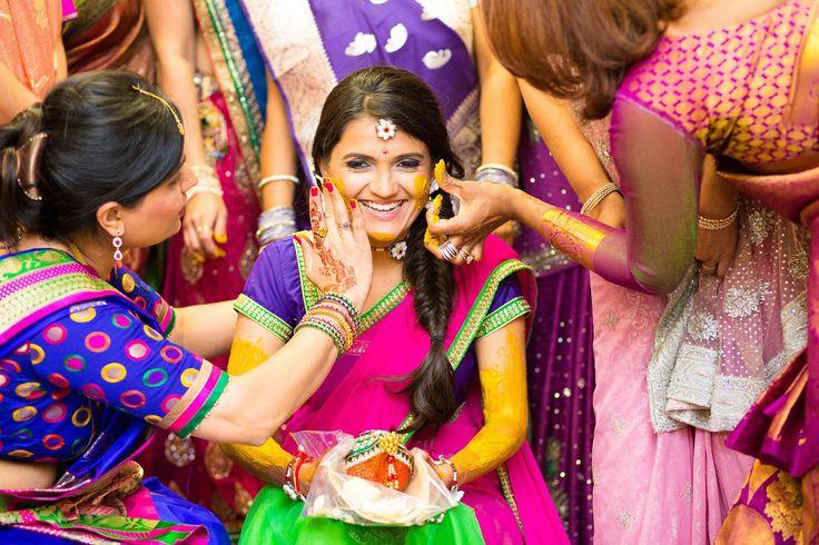 Pretty bride snickering with joy at her haldi function.