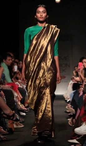 A stunning gold zari sari by designer Sanjay Garg of Raw Mango. Shop for the perfect wedding sari for your mother or mother-in-law with a personal shopper & stylist in India - Bridelan, visit our website www.bridelan.com #Bridelan