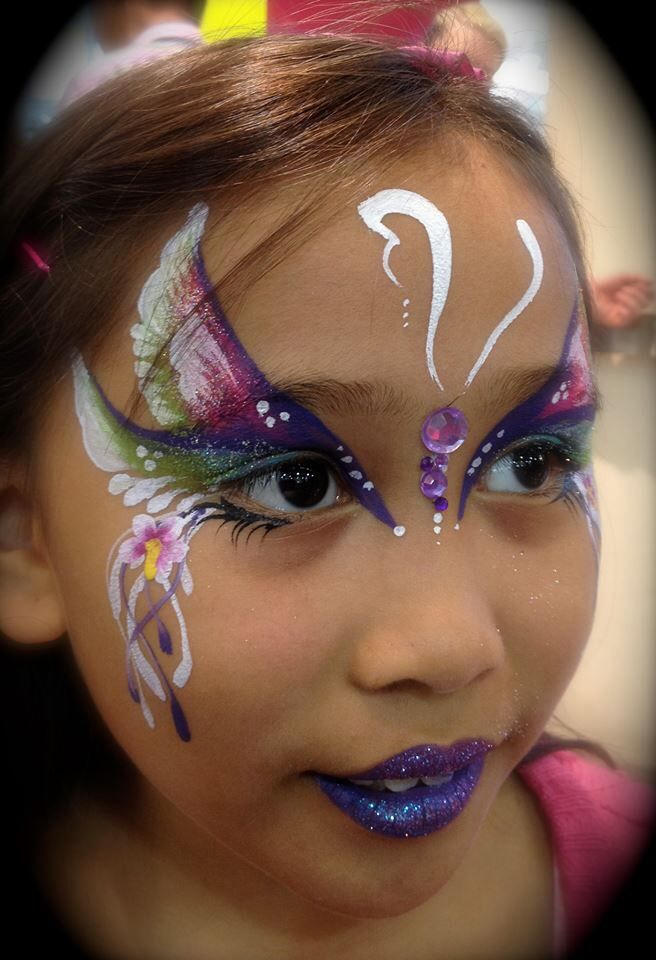 Beautiful unusual butterfly by Annie Reynolds face painting ideas for kids