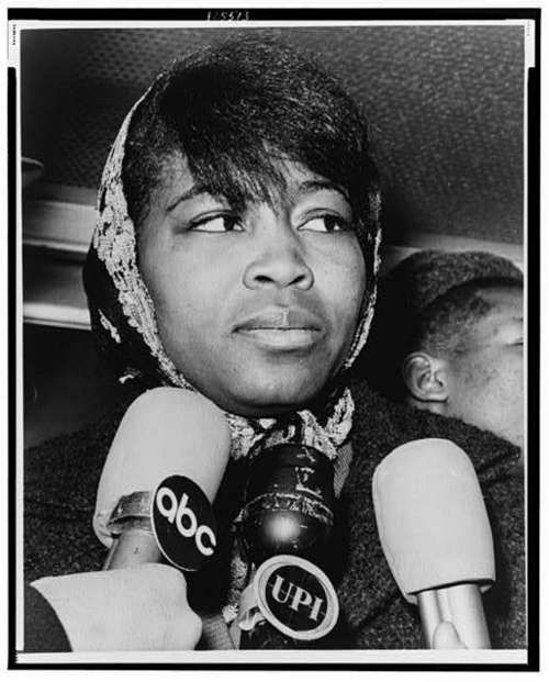 Mrs. Betty Shabazz, leaving Bellevue Hospital morgue after identifying the body of her slain husband, Malcolm X, New York City - 1965.