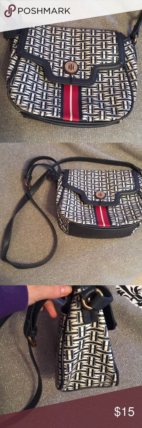 Blue and white cross body purse/ inside pockets Tommy Hilfiger cross body purse that has lots of room! Great for traveling and trips! Small amounts of fading on the back but not noticeable when wearing it Tommy Hilfiger Bags Shoulder Bags